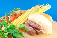 Mediterranean diet. Mediterranean food composition with sausage, cheese, spaghetti and tomato Royalty Free Stock Image