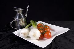 Mediterranean Diet. Consisting of a tomato, an onion and oil base Royalty Free Stock Photos