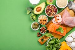 Mediterranean diet concept - meat, fish, fruits and vegetables. On bright green background royalty free stock photo
