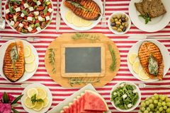 Mediterranean diet. Healthy eating concept. Top view. Top view of table with fish, salads, fruits and vegetables. Mediterranean diet. Healthy food concept royalty free stock image
