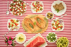 Mediterranean diet. Healthy eating concept. Top view. Top view of table with fish, salads, fruits and vegetables. Mediterranean diet. Healthy food concept royalty free stock photography
