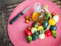 Mediterranean diet. Olive oil, cherry tomatoes and pepper Royalty Free Stock Image