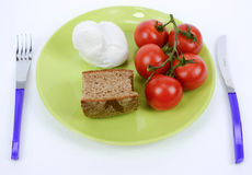 Mediterranean diet tomato, mozzarella and brown bread Royalty Free Stock Photography