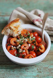 Mediterranean dish with roasted cherry tomatoes Stock Photography