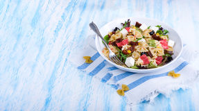 Mediterranean Farfalle salad with dry tomatoes and pine cores. A Mediterranean Farfalle salad with dry tomatoes and pine cores Stock Images