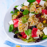 Mediterranean Farfalle salad with dry tomatoes and pine cores. A Mediterranean Farfalle salad with dry tomatoes and pine cores Royalty Free Stock Photo