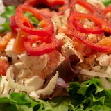 Mediterranean farmers salad with green salad leaves, red pepper and sheep cheese. Food royalty free stock photography
