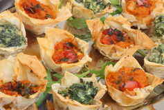 Mediterranean Filo Pastry Canapes. Filo tartlets filled with spinach and ricotta or tomato and red pepper Royalty Free Stock Images