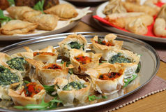 Mediterranean Filo Tartlet Canapes. Filo pastry tartlets filled with spinach & ricotta or tomato & red pepper Stock Photos