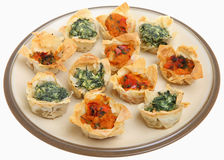 Mediterranean Filo Tartlets. Filo tartlets filled with spinach and creamy ricotta, and tangy tomato and red pepper Stock Image