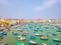 Mediterranean fishing village Marsaxlokk, Malta. Traditional eyed colorful boats Luzzu in the Harbor of Mediterranean fishing village Marsaxlokk, Malta Royalty Free Stock Photos