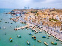 Mediterranean fishing village Marsaxlokk, Malta. Traditional eyed colorful boats Luzzu in the Harbor of Mediterranean fishing village Marsaxlokk, Malta Stock Photography