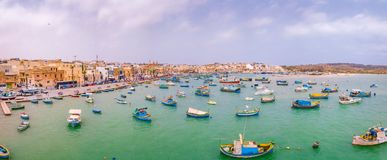 Mediterranean fishing village Marsaxlokk, Malta. Traditional eyed colorful boats Luzzu in the Harbor of Mediterranean fishing village Marsaxlokk, Malta Stock Photos