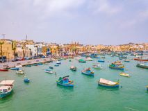 Mediterranean fishing village Marsaxlokk, Malta. Traditional eyed colorful boats Luzzu in the Harbor of Mediterranean fishing village Marsaxlokk, Malta Stock Images