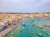 Mediterranean fishing village Marsaxlokk, Malta. Traditional eyed colorful boats Luzzu in the Harbor of Mediterranean fishing village Marsaxlokk, Malta Royalty Free Stock Image