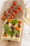 Mediterranean flat bread on wooden board Stock Photos