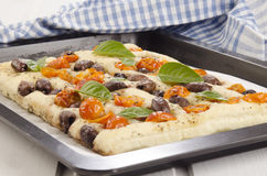 Mediterranean flatbread with cherry tomatoes and olives Stock Photography