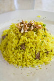 Mediterranean food. A dish of yellow rice and meat with sauce Royalty Free Stock Image