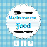 Mediterranean food. Abstract colorful background with blue table cover, fork, knife and the text Mediterranean Food written in blue. Restaurant menu concept Stock Photography