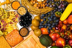 Mediterranean Food background. Assortment of fresh fruits and vegetables Top view. Mediterranean Food background. Assortment of fresh fruits, vegetables, nuts Stock Photos