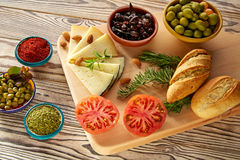 Mediterranean food bread oil olives cheese. Spices peppers garlic almods rosemary Stock Images