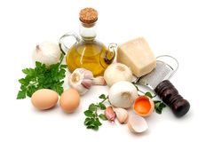 Mediterranean food ingredients. Olive oil, garlic, onion, eggs and parmesan cheese all isolated over white Stock Image