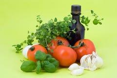 Mediterranean food ingredients. Olive, tomatoes, garlic, basil and oregano Royalty Free Stock Photo