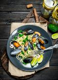 Mediterranean food. Seafood spaghetti with clams and white wine. On a wooden background royalty free stock photos
