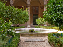 Mediterranean garden. With trees and fountain Stock Photos