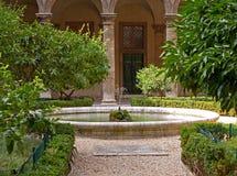 Mediterranean garden. With trees and fountain stock photos