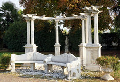 Mediterranean garden. Stone bench and columns centre a peaceful Mediterranean garden Royalty Free Stock Photo