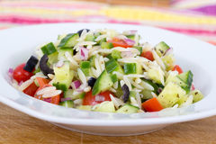 Mediterranean greek orzo pasta salad. With black olive, red onion and cucumber Royalty Free Stock Images
