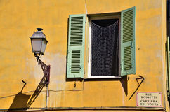 Mediterranean green and yellow window. In french Riviera town Royalty Free Stock Images