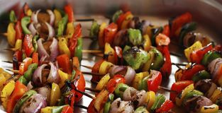 mediterranean grilled vegetable skewers in a serving dish stock images