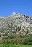 Mediterranean hill recovering after forest fire. A rocky hill in the Mediterranean, recovering a year after a devastating forest fire Stock Photo