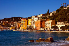 Mediterranean hillside city in France with harbor royalty free stock photos