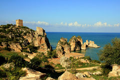 Mediterranean holiday. Coast rocks & sea. Sicily Stock Photography