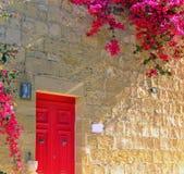 Mediterranean Home. Typical limestone Mediterranean house facade with bouganvilla Royalty Free Stock Photo