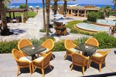 Mediterranean hotel resort and al fresco wicker seats, Greece Royalty Free Stock Image