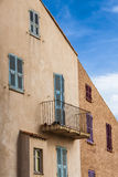 Mediterranean house with colorful window shutters Stock Photo