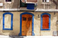Mediterranean house facade. Facade of a blue and white Mediterranean house Royalty Free Stock Photo
