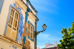 Mediterranean house facade with crumbling white and blue paintin. G Stock Images