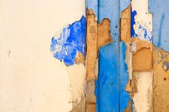 Mediterranean house facade with crumbling white and blue paintin. G Stock Image