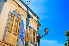 Mediterranean house facade with crumbling white and blue paintin. G Stock Photography