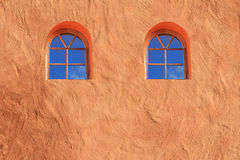 Mediterranean house facade, with two arched Windows, plastered p Royalty Free Stock Photo