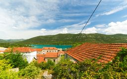 Mediterranean houses with red roofs and Adriatic Sea in the background, Dalmatia, Croatia Stock Photos