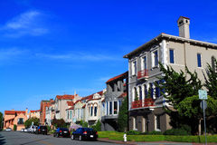 Mediterranean Houses. San Francisco Houses Mediterranean style with green lawn and blue sky Stock Photography