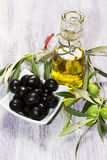 Mediterranean ingredients: green and black olives and olive oil virgen extra Stock Photos