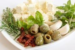 Mediterranean ingredients. Platter of mediterranean ingredients and herbs Royalty Free Stock Photos