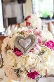 Mediterranean interior - flower bouquet. Mediterranean interior - a flower bouquet with a heart ornament Stock Image